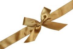 Goldenes Farbband und Bogen des Geschenks Stockfotos