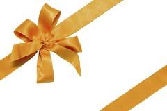 Goldenes Farbband und Bogen des Geschenks Stockbilder
