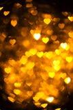 Goldenes Farbherz bokeh Hintergrundfoto Abstrakter Feiertag, Feierhintergrund Lizenzfreie Stockbilder