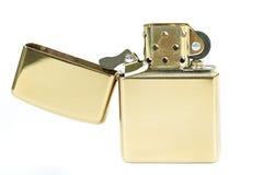 Goldenes Feuerzeug. Stockbild