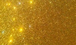 Goldenes Funkeln maserte Hintergrund, helles schönes glänzendes goldenes Funkeln stockbilder