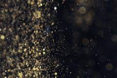 Goldenes Funkeln mit bokeh Effekt lizenzfreie stockfotos