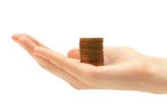 Goldenes Geld in der Hand stockfotos
