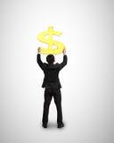 Goldenes Geldsymbol des Geschäftsmanngriffs 3D Stockfoto