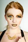 Goldenes Gesicht Lizenzfreie Stockbilder