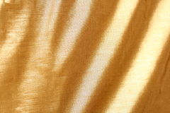 Goldenes Gewebe Stockfotos
