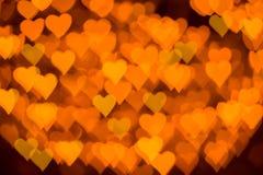 Goldenes Herzen bokeh als Hintergrund Lizenzfreies Stockfoto