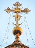 Goldenes Kreuz Stockfoto