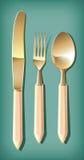 Goldenes Löffel-, Gabel- und Tabellenmesser | Vektorwelt Stockfoto