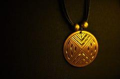 Goldenes Medaillon stockbilder