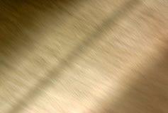Goldenes metallisches Hintergrundunschärfe. Lizenzfreies Stockbild