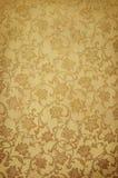Goldenes Muster auf Tapete Stockfoto