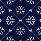 Goldenes nahtloses mit Blumenmuster auf blauem Hintergrund Lizenzfreie Stockbilder
