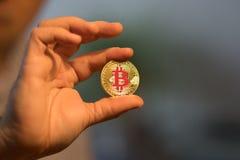 Goldenes neues virtuelles Geld Bitcoins Stockbilder