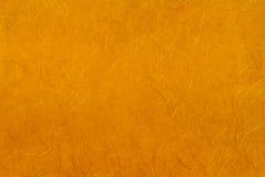 Goldenes Papier mit Goldgewinde. Lizenzfreies Stockfoto
