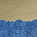 Goldenes Papier und Blue Jeans Lizenzfreies Stockfoto