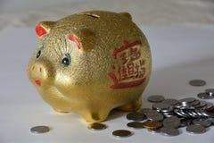 Goldenes piggy Sparschwein Lizenzfreie Stockfotos