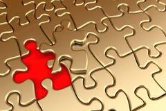 Goldenes Puzzlespiel Stockbild