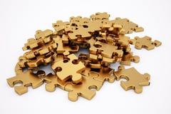 Goldenes Puzzlespiel Stockfotografie