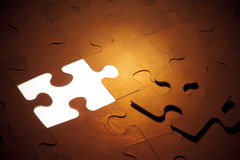 Goldenes Puzzlespiel Stockbilder