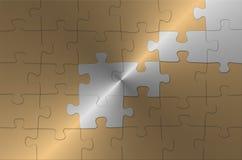 Goldenes Puzzlespiel Stockfoto