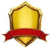 Goldenes Schild und Farbband Stockbild