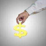 Goldenes Symbol des Geldes 3D des Handgriffs Lizenzfreies Stockfoto