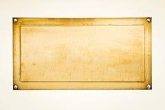 Goldenes unbelegtes Zeichen Lizenzfreies Stockbild