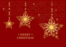 Goldenes Weihnachten spielt mit Schneeflocken auf einem roten Hintergrund die Hauptrolle Holi Stockfotos