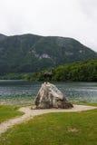 Goldenhorn statue on Bohinj lake, Slovenia Royalty Free Stock Images