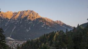 Goldenhour lighting up mountain top royalty free stock photos