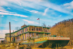 Goldenrod Showboat aground on the Mississippi River. The Goldenrod Showboat is aground in antiquity along the Mississippi River with its decayed grandiosity Royalty Free Stock Images