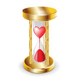 Golder hourglass and red heart Royalty Free Stock Image