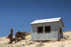Goldförderung-Stempel-Tausendstel und Gebäude Stockbild