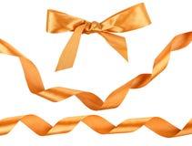 Goldfarbbänder getrennt auf Weiß Lizenzfreies Stockbild