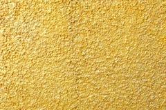 Goldfarben-Stuck-Wand Stockbild