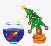 Goldfish and Christmas fir-tree. Stock Photo