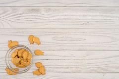 Goldfish cracker in a glass bowl on a white wooden table. Stock Images