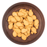 Goldfish Crackers in brown plate. Isolated on white background. Royalty Free Stock Image