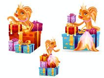 Goldfish and gifts Royalty Free Stock Image