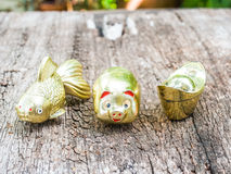 Goldfish, Gold pig, Gold ingot. Chinese symbol means abundance of gold and wealth Stock Images
