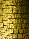 Goldfliesen Stockbild
