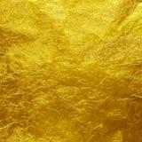 Goldfolien-Beschaffenheitshintergrund Lizenzfreie Stockfotos
