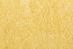 Goldfolien-Hintergrundbeschaffenheit Stockbild