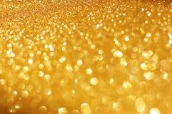 Goldfrühling oder Sommerhintergrund. Eleganter abstrakter Hintergrund mit bokeh defocused Lichtern Stockfotos
