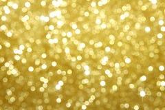 Goldfunkeln-Auszugshintergrund Lizenzfreies Stockfoto