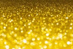 Goldfunkeln bokeh Zusammenfassungshintergrund Lizenzfreies Stockfoto