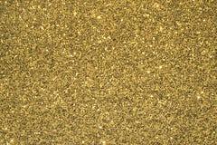 Goldfunkeln-Hintergrund Lizenzfreies Stockfoto