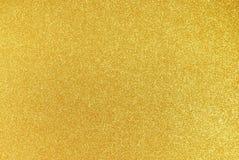 Goldfunkeln-Hintergrund Stockfotografie