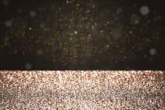 Goldfunkeln mit schwarzem Hintergrund Lizenzfreie Stockbilder